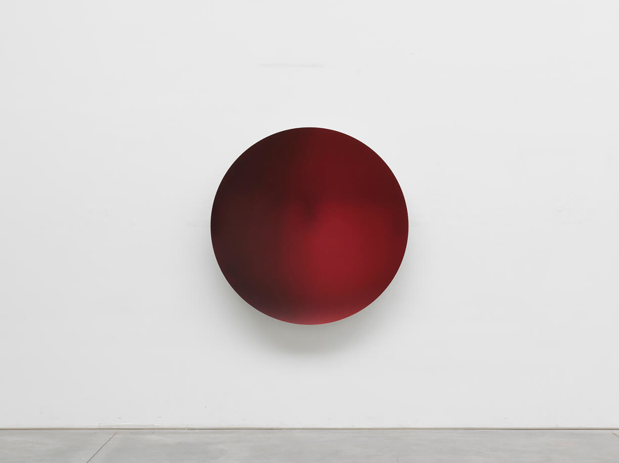 """<p>For the third exhibition in East Hampton, Lisson Gallery is pleased to present a recent sculpture by <a href=""""https://www.lissongallery.com/artists/anish-kapoor"""" target=""""_blank"""">Anish Kapoor</a>. This will be the artist&rsquo;s second exhibition with the gallery in the United States, following his <a href=""""https://www.lissongallery.com/exhibitions/anish-kapoor-lisson-nyc"""" target=""""_blank"""">dual presentation at both of Lisson Gallery&rsquo;s New York spaces</a> in October 2019.</p>  <p>Kapoor is one of the most celebrated and influential sculptors of his generation, known for his monumental and ambitious public structures, as well as his continuous exploration into the manipulation of space throughout his artistic practice. Kapoor&rsquo;s highly anticipated exhibition at the historic Houghton Hall in Norfolk, England opened in July and runs until November 2020, featuring 21works including the 16-foot stainless steel <em>Sky Mirror</em>.</p>  <p>The sculpture on view in East Hampton, <em>Garnet to Laser Red </em>(2017), is a wall-based semi-reflective concave mirror that fades subtly across shades of deep red. The mirrored surface as a material represents a key component of Kapoor&rsquo;s oeuvre, whereby both its flawlessly polished surface and the distorted reflection it creates when shaped into highly innovative form, force the viewer to re-examine their relationship to the surrounding environment. The faintly reflective surface coupled with the vibrant, dark crimson in <em>Garnet to Laser Red </em>additionally creates a sense of electricity and intensity &shy;&mdash; invigorating the intimately scaled space.&nbsp;</p>  <p>For its inauguration this summer, Lisson Gallery&rsquo;s 1,000 square foot <a href=""""https://www.lissongallery.com/news/lisson-gallery-opens-in-east-hampton"""" target=""""_blank"""">East Hampton space</a> will highlight one work per week by gallery artists &ndash; with presentations by Stanley Whitney, Carmen Herrera, Joanna Pousette-Dart, Sean Scully and"""